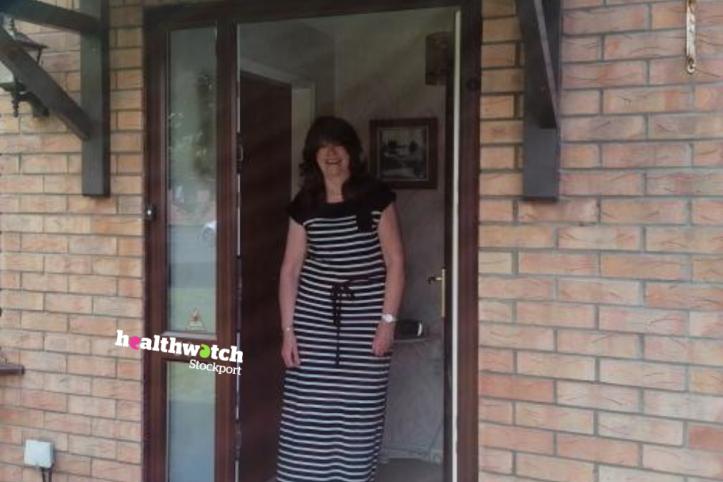 Maria standing in door