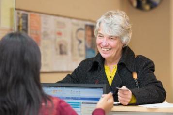 Woman smiling at GP