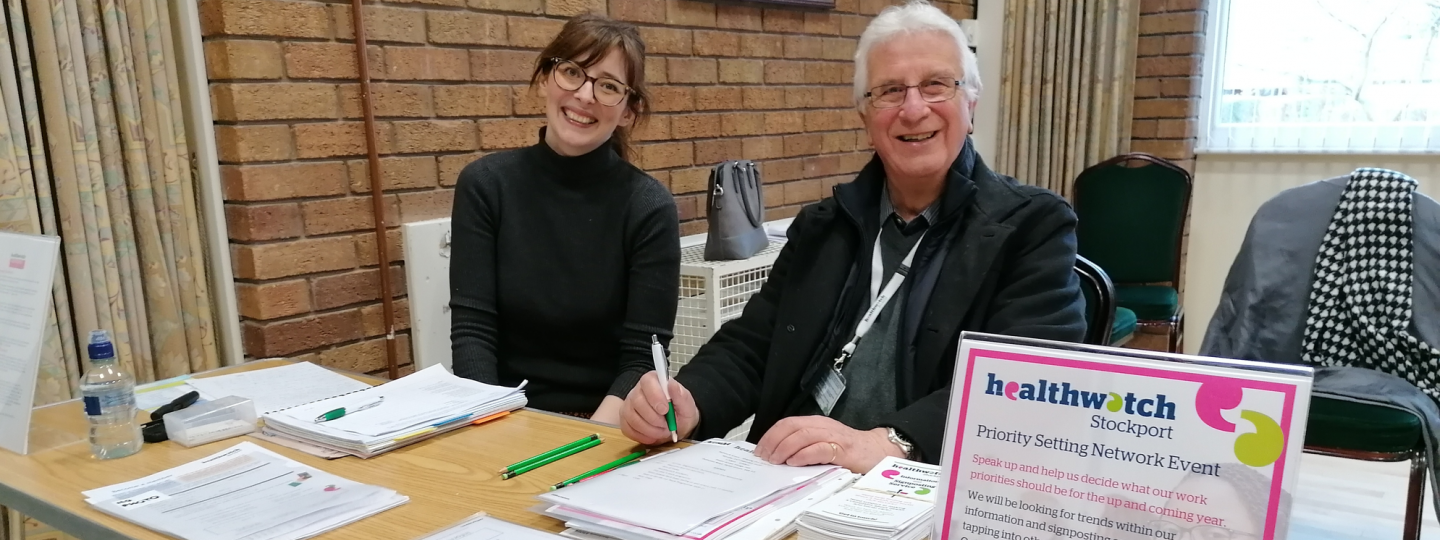 Healthwatch volunteer at a community event speaking to the public